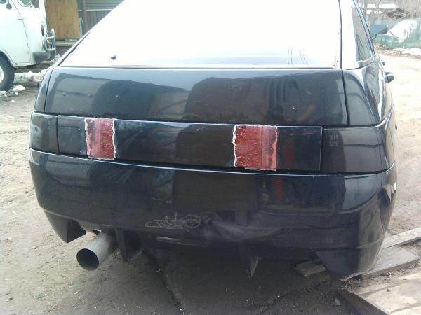 Отремонтированный при помощи волокна задний бампер